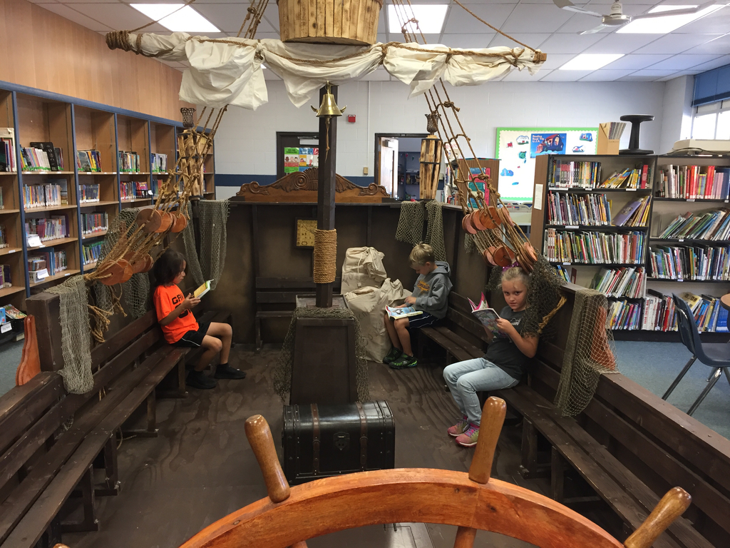 Superkids of the week reading in the pirate ship.
