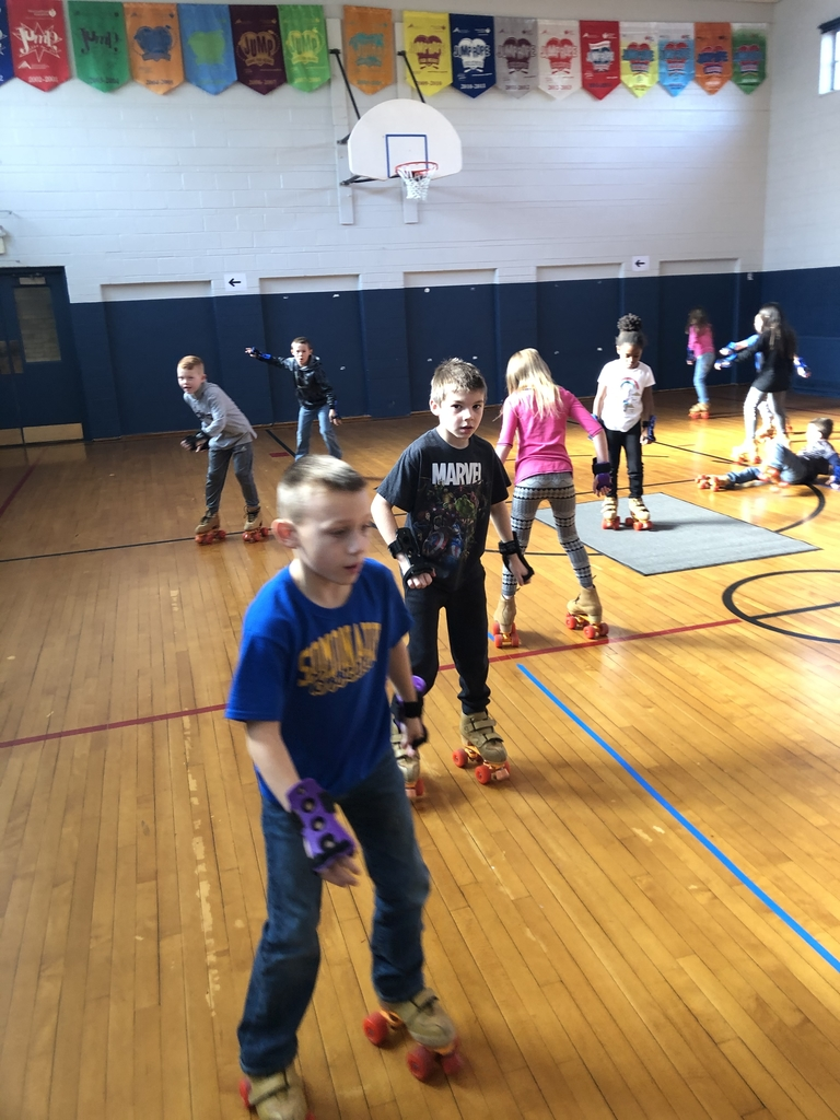Third grade working on forward and backward skating.